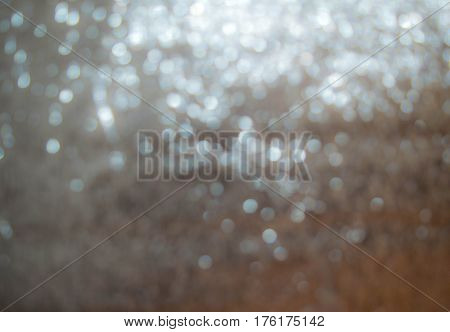 Surface foil pattern round spots a blurred photograph.