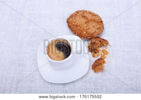 Fresh homemade muffin, cake and white cup of Cappuccino on white background