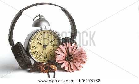 Isolated Potpourri in Front of Vintage Alarm Clock with Roman Numeral and Copy Space. Listening to Music Concept and Relaxtion Cozy Mood