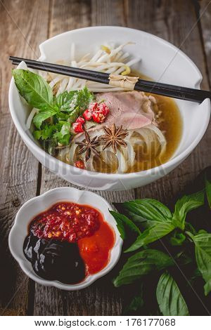Pho Vietnamse Noodle Soup on Old Wood. Image for Food Advertise Concept