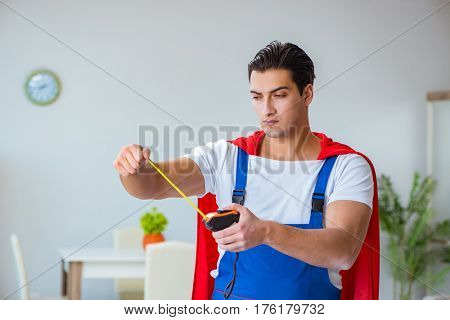 Super hero repairman working at home