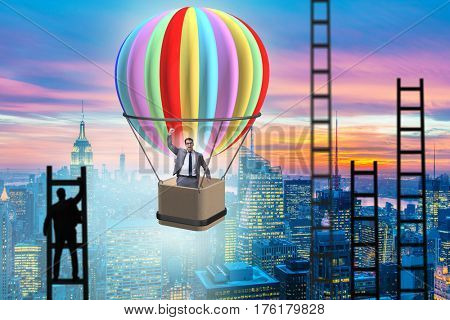 Career achievement concept with businessman on balloon and ladde