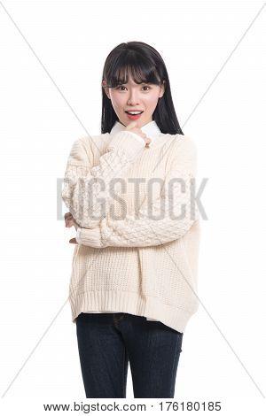 Studio portrait of happy twenties Asian woman