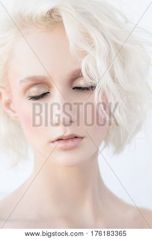 Glamour portrait of beautiful blonde woman. Nude make up. A blonde woman with short and wavy hair. Everyday make-up.