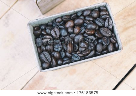 coffee beans in the container in flat lay scene