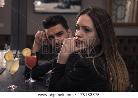 Young Man Looking At Woman, Looking Away