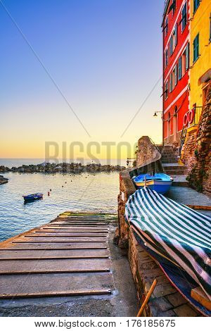 Riomaggiore village boats and sea in Five lands on sunset Cinque Terre National Park Liguria Italy Europe.