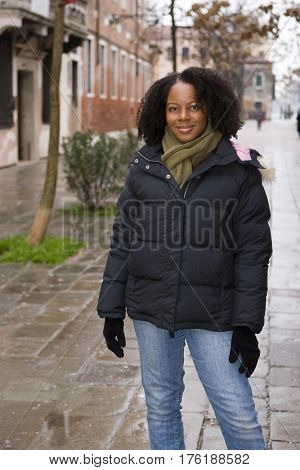 African American woman outside at winter time.
