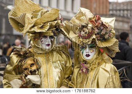Festival dress and mask in Venice carnival.