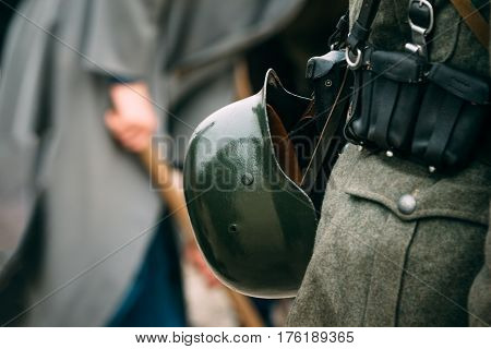 Helmet of the soldier of the German army of the Second World War, fastened to the belt and equipment