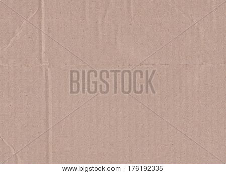 Brown vintage cardboard texture or cardboard surface.
