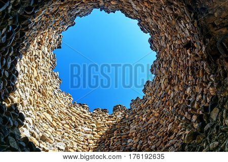 Looking at the sky through hole in tower. Sighnaghi city wall. It is City of Love in Georgia with many couples visiting it just to get married. Kakheti region