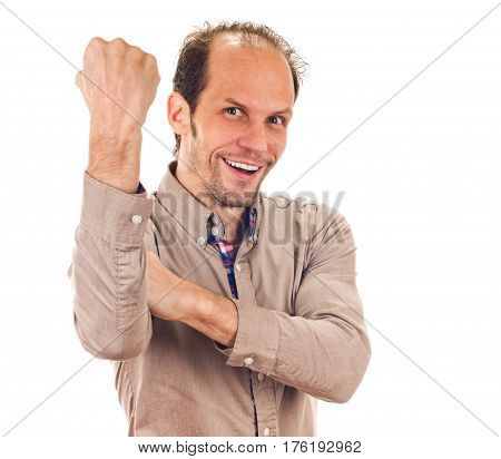 Portrait of cheerful man showing fuck off gesture with hands
