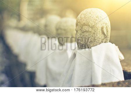 Japanese stone statue Ksitigarbha Bodhisattva in garden.