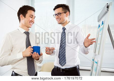 Young businessmen discussing a new project at modern office