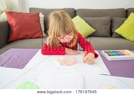 Red Shirt Child Drawing With Crayons