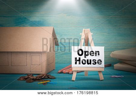 Open House. home model, money and a notice board under the sunlit.