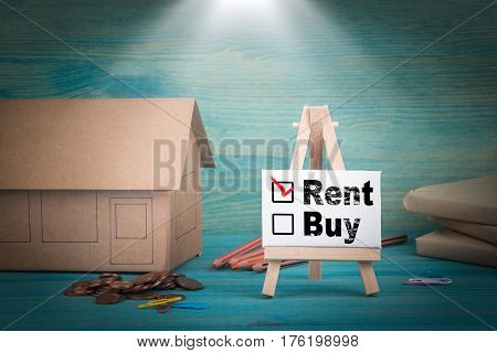 for rent. home model, money and a notice board under the sunlit.