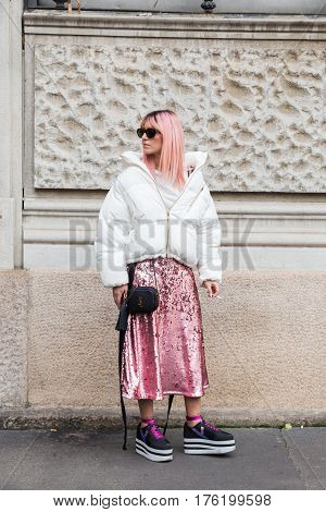MILAN ITALY - FEBRUARY 26: Fashionable woman poses outside Ferragamo fashion show during Milan Women's Fashion Week on FEBRUARY 26 2017 in Milan.