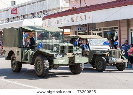 Charters Towers - April 25 2016: Proud ex-servicemen ride in old army vehicles in Anzac Day parade in Charters Towers Queensland Australia