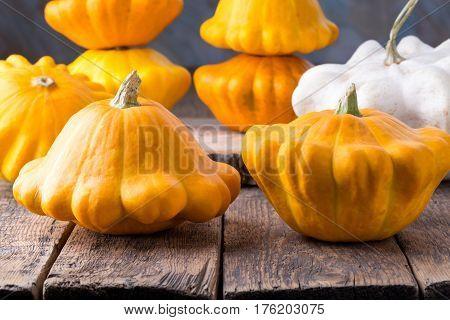 Fresh yellow pattypan squash on wooden table