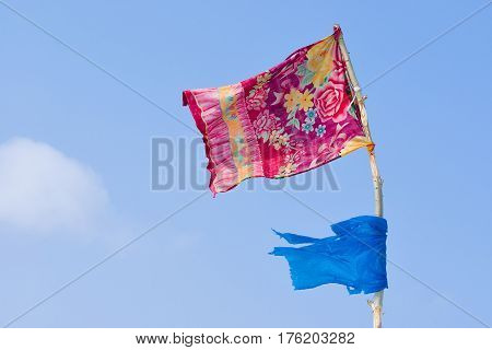 Flag of homeless against blue sky .