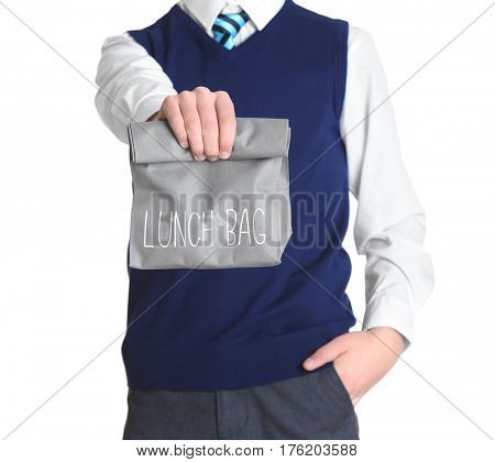 Cute schoolboy with lunch bag on white background, closeup