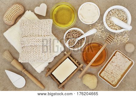 Ingredients for skin and body care beauty treatment on natural hemp paper background.