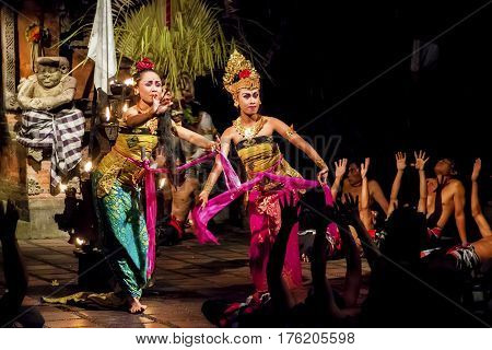 Denpasar, Bali, Indonesia - September 9th, 2014: Female Dancers Performing Traditional Balinese Dance Kecak Accompanied by Male Voice Choir during Hindu Ceremony in Small Village Near Denpasar.