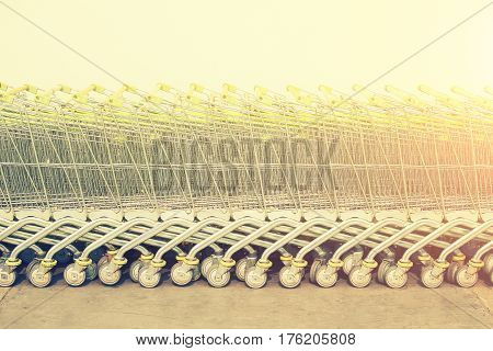 Shopping cart with white wall background, vintage color tone.