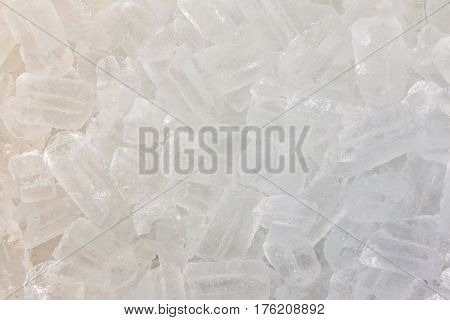 Texture of clear ice cubes background, food and drink industry.