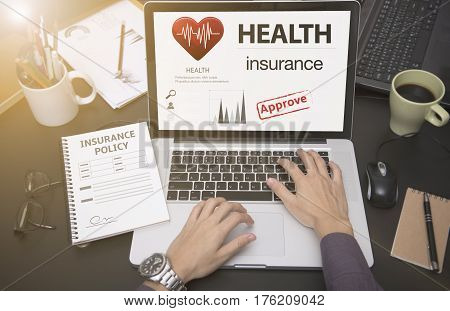 business hand using computer with protection health insurance policy page. concept accident prevention coverage.