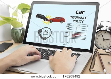 business hand using computer with protection car insurance policy page. concept accident prevention healthcare.