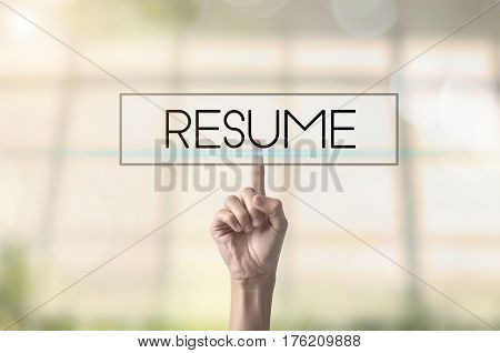 Businessman hand pressing button Resume. sign on virtual screen. business now hiring concept.