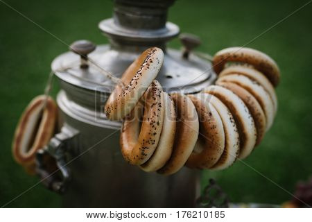A Samovar With A Bunch Of Bagels Hanging On It