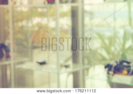 Show room customer service of car part blur background decor garden concept Photo in office looking out of shelf and glass wall to relax has green garden and tree color retro tone.