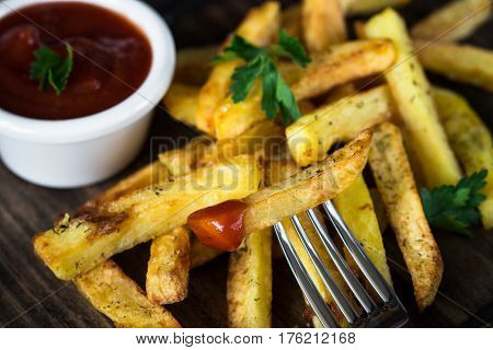 Fried potato with ketchup sauce and drink. Fast food menu.