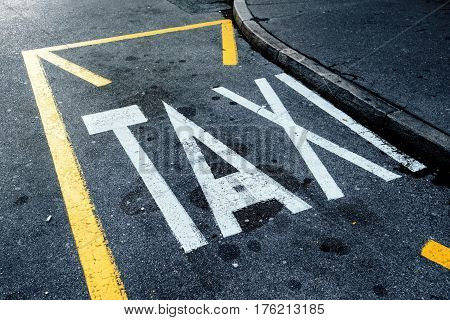 Taxi station and parking space on the street sign painted on asphalt road