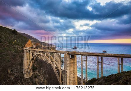 Classic View Of Historic Bixby Bridge Along Famous Highway 1 In Twilight, Big Sur, California, Usa