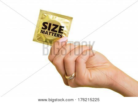 Woman holding a condom wrapper with size matters