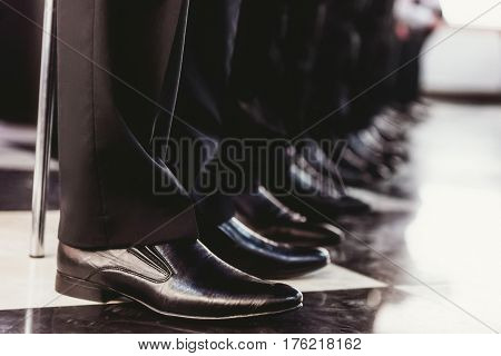 Elegant and stylish mens black shoes standing in one line
