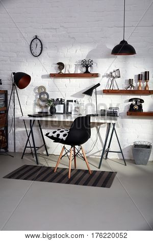 Stylish study with desk and chair.