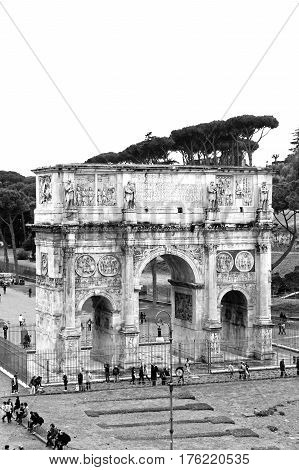 The arch of Constantine near to Coliseum. Monochrome photography. The Arch of Constantine is a triumphal arch in Rome situated between the Colosseum and the Palatine Hill.