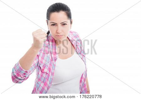 Young Brunette Woman Throwing A Punch
