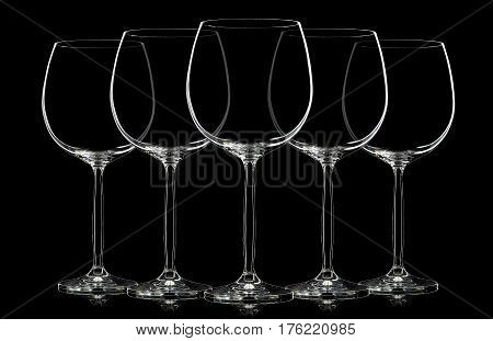 Silhouette of wine glass on black background.
