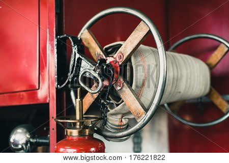 Close-up Of Coiled Fire Hose Of Old Fire Truck.
