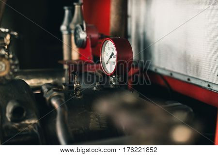 Pressure meter of an old fire truck.
