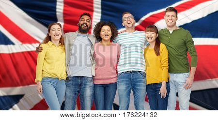 immigration, diversity, race, ethnicity and people concept - international group of happy smiling men and women over english flag background