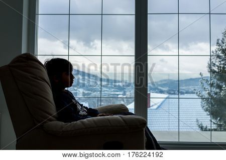 Child standing on home window
