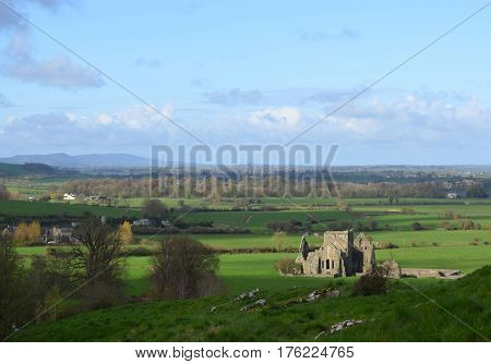 Hore Abbey bathed in sunlight and shadows.
